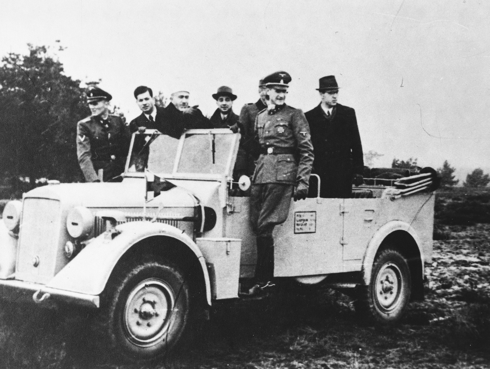 Hajj Amin al-Husayni rides in an open jeep in the company of German SS and civilian officials during an official visit to Bosnia.