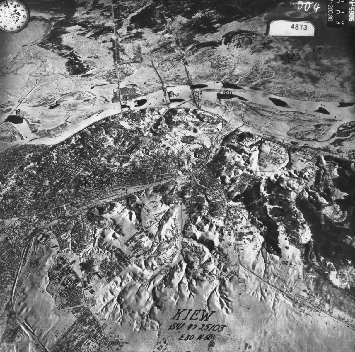 An aerial photograph of the city of Kiev, taken by the German air force.  The ravine of Babi Yar is not visible, but lies just off the bottom left margin of the image. [Oversized Print]