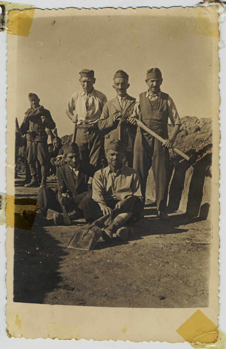 A group of Hungarian Jewish men pose with shovels in a Hungarian labor battalion.  Among those pictured is Chaskel Ehrenreich, uncle of the donor.  He and all of his family perished in the Holocaust.