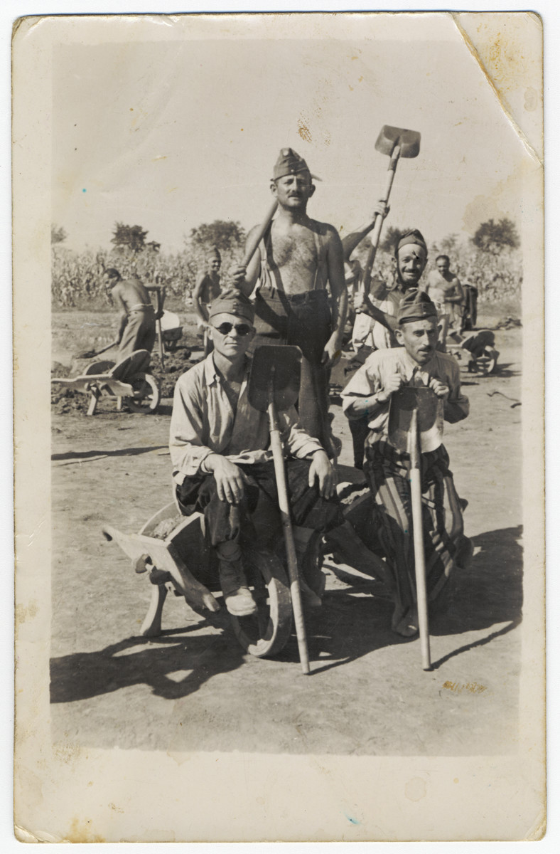 Four Hungarian Jewish men pose with shovels in a Hungarian labor battalion.  Pictured in the front left is Chaskel Ehrenreich, uncle of the donor.  He and all of his family perished in the Holocaust.