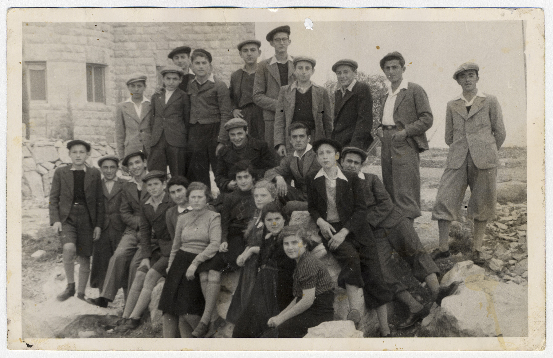 Recent Youth Aliyah immigrants to Palestine gather in front of the Horev boarding school.  Among those pictured is Meir Schwarz, first row, second from the left.