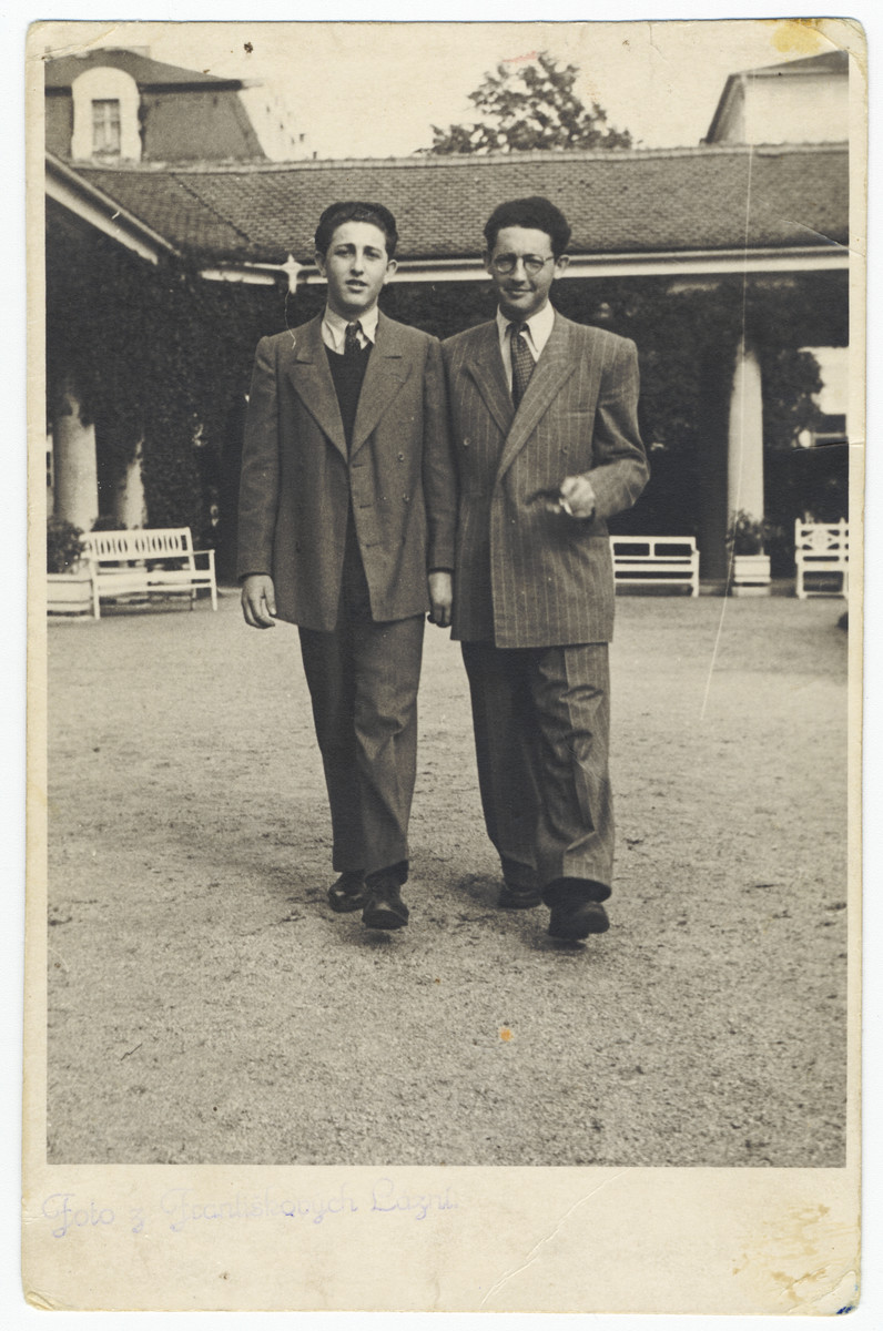 Two brothers walk outside a building a few years after liberation.    Pictured are Nisen (left) and Herman Ganz (right).