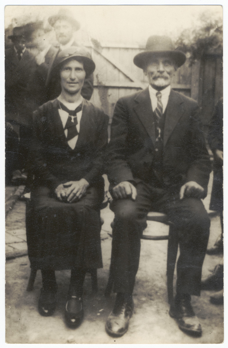 Close-up portrait of a religious Jewish couple sitting in their yard.   Pictured are Perel and Avraham Yankel Leitman, the grandparents of the donor.