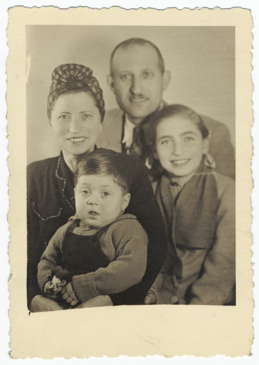 Postwar portrait of a Jewish family in Budapest.  Pictured are Olga, Eliezer, Eva and Yakov Freedman.