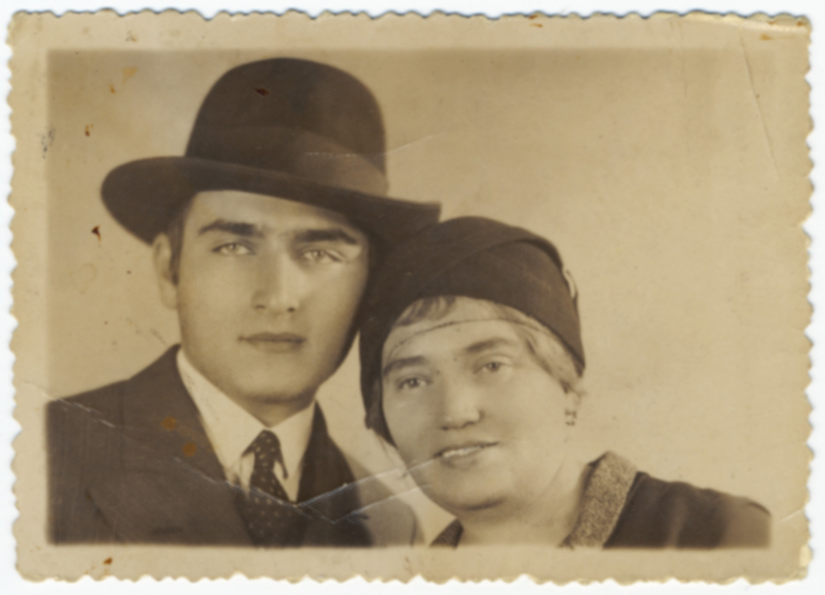 Close-up portrait of a religious Jewish man and his mother.  Pictured are Laszlp (Moishe Tovia) Weiss and his mother Sara Weiss, the father and grandmother of the donor.