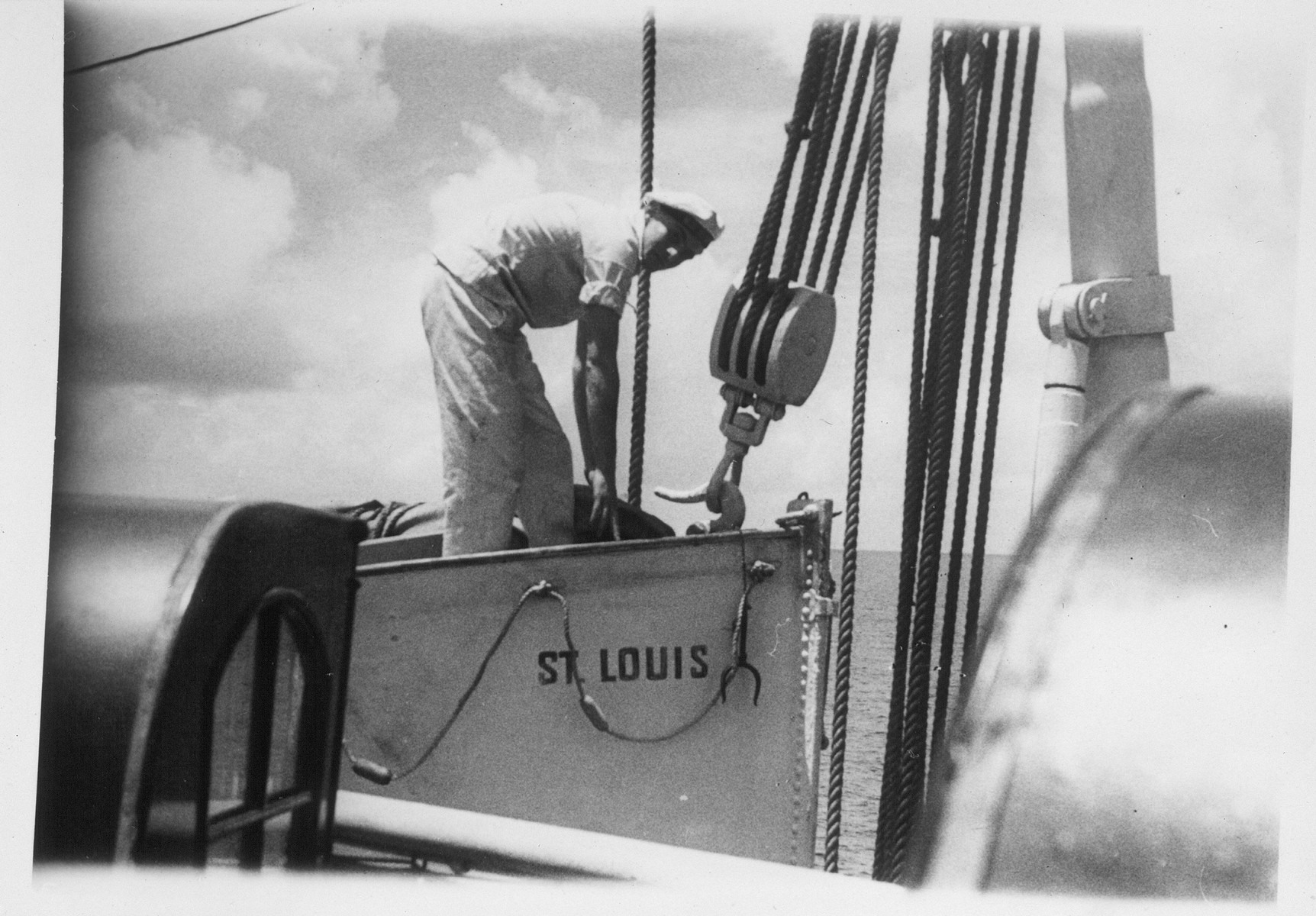 A crew member stows equipment in a lifeboat on the MS St. Louis.