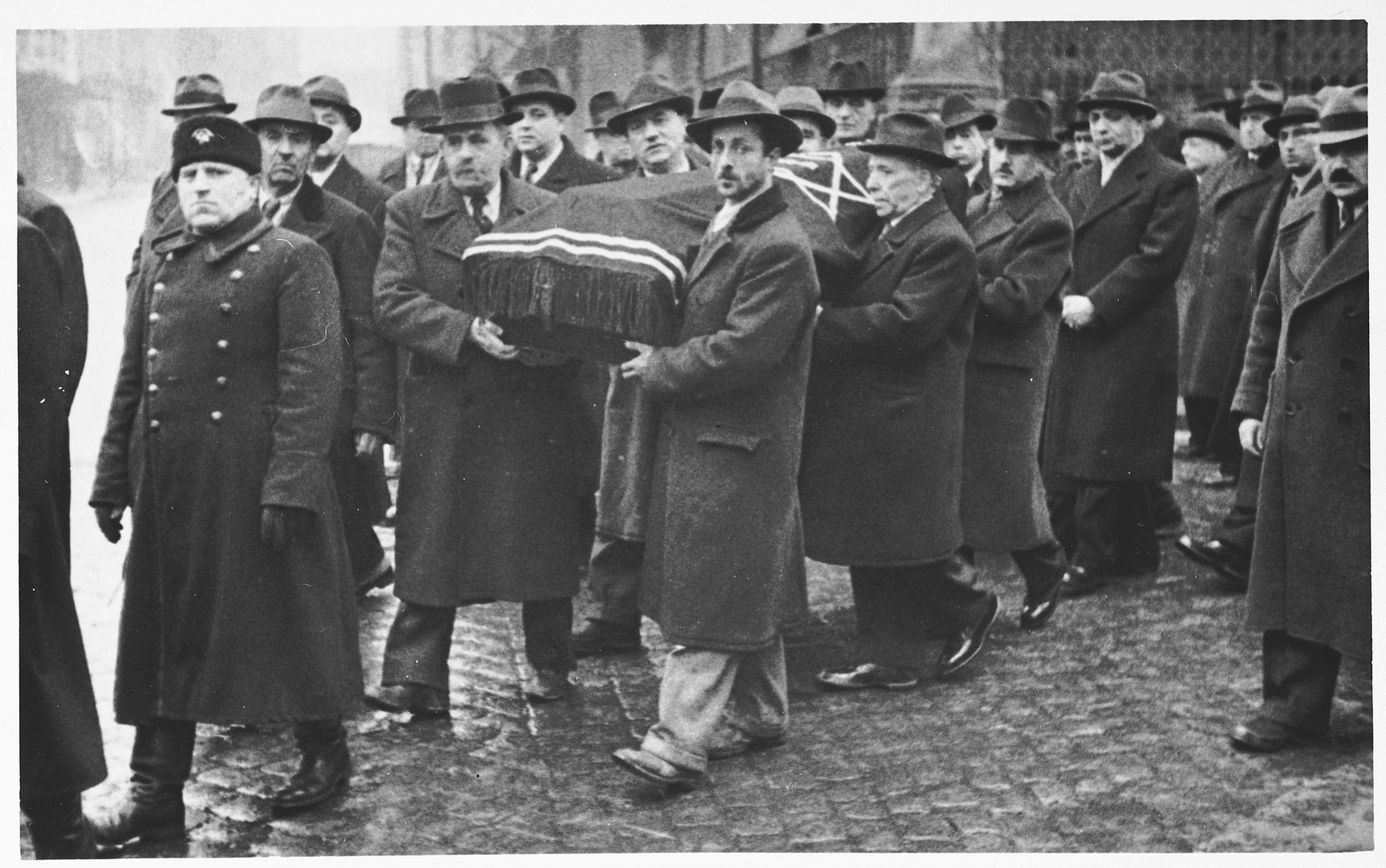 Mourners carry the coffin of Nissim Yasharoff (the donor's grandfather) during a funeral procession in Sofia.  The funeral took place a few days after the arrival of German troops in Bulgaria.