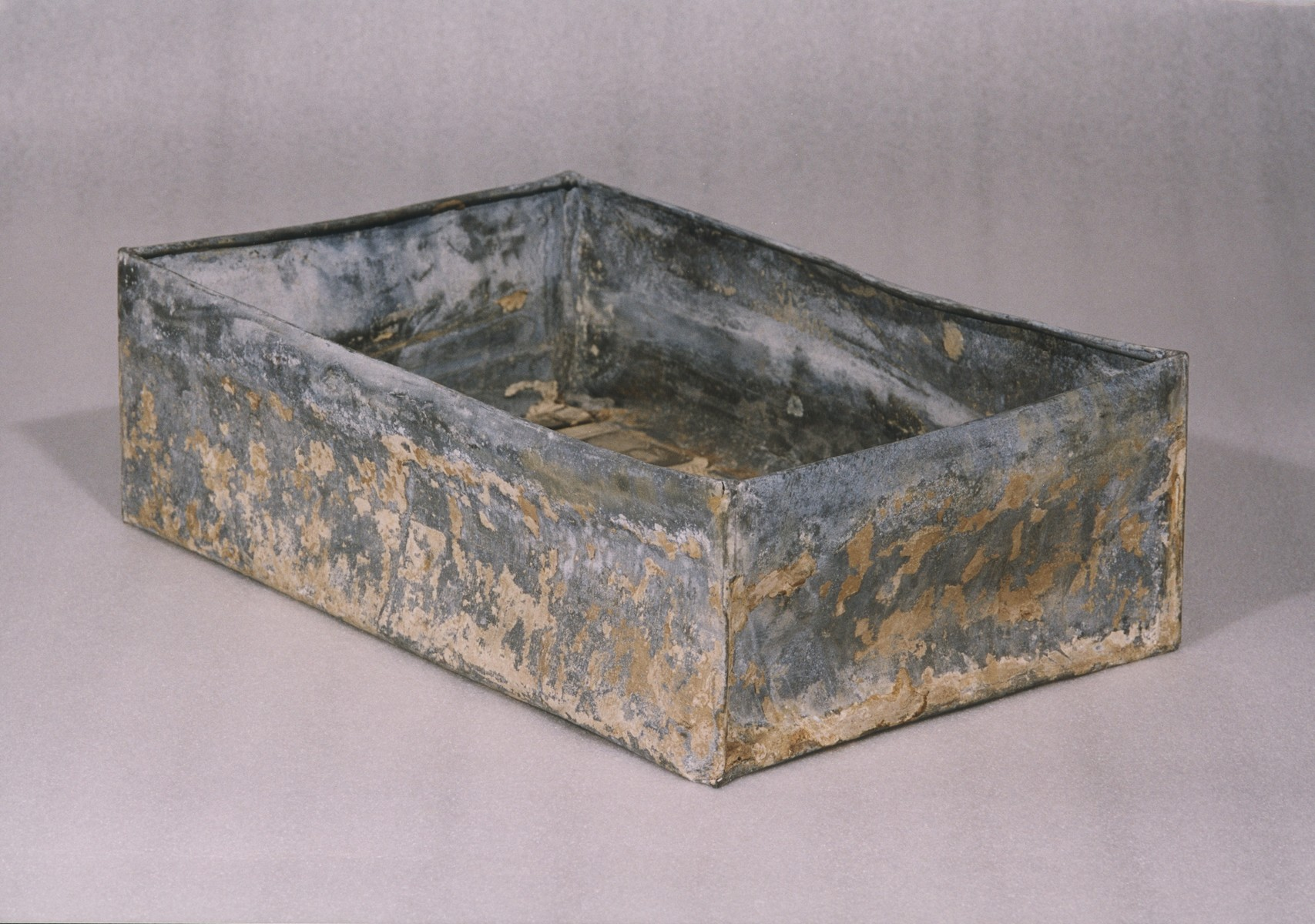 One of the ten metal boxes in which portions of the Ringelblum Oneg Shabbat archives were hidden and buried in the Warsaw ghetto.  The boxes are currently in the possession of the Jewish Historical Institute in Warsaw.  This view is of an open box without the lid.