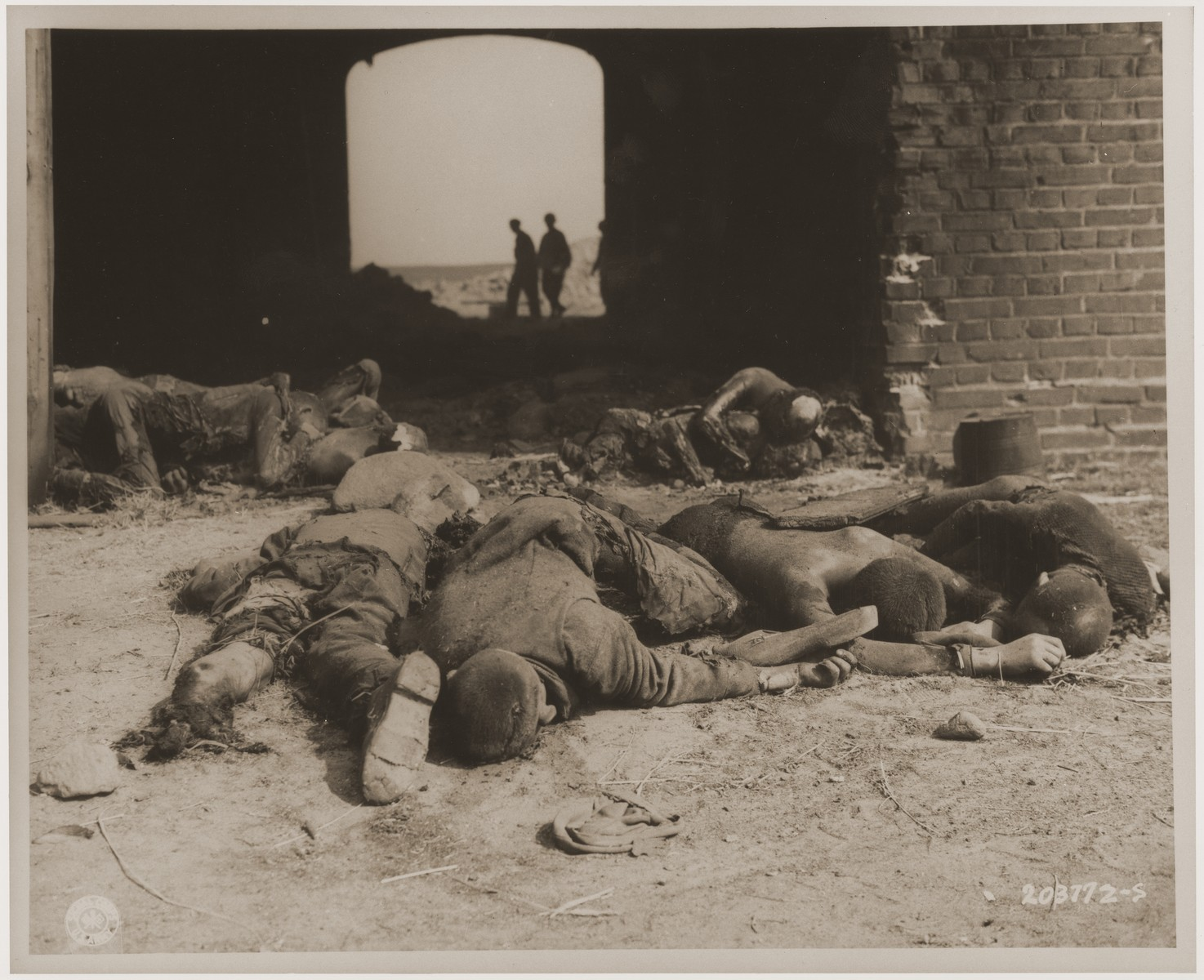 The charred bodies of prisoners burned alive by the SS lie outside of a barn on the outskirts of Gardelegen.