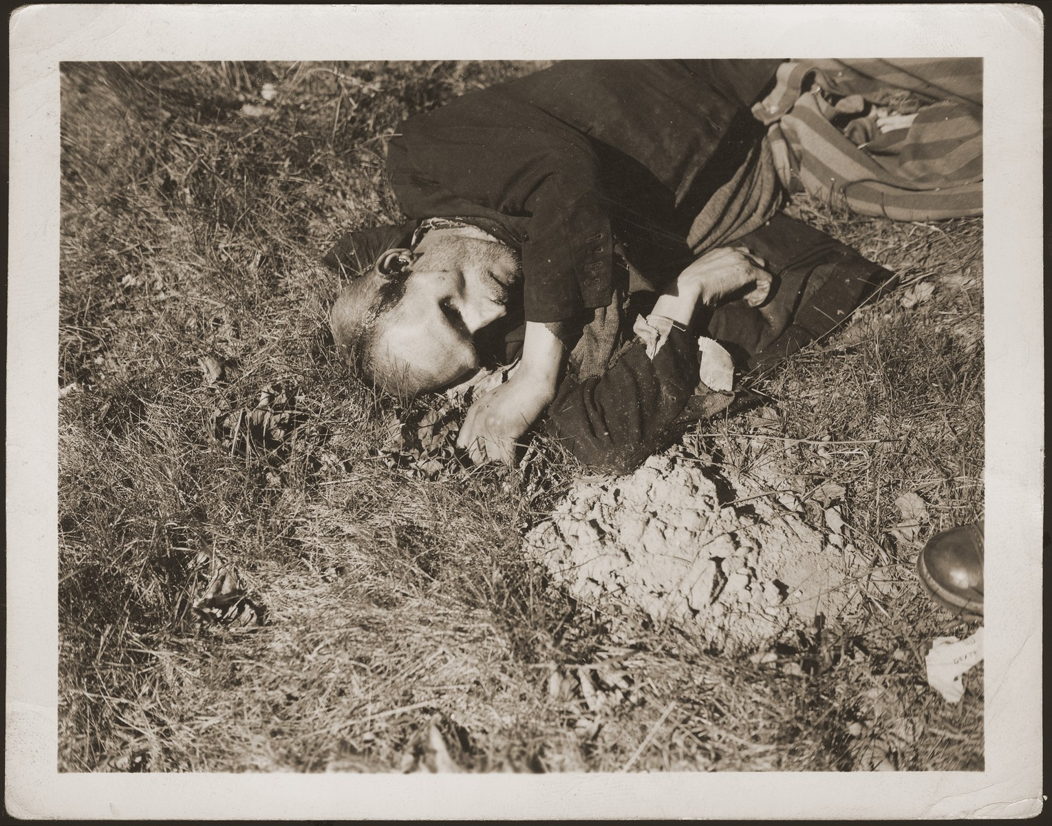 The body of a prisoner shot on the road near Gardelegen.  The prisoner was shot by the SS when he was too exhausted to continue on a death march from the nearby town of Mieste.
