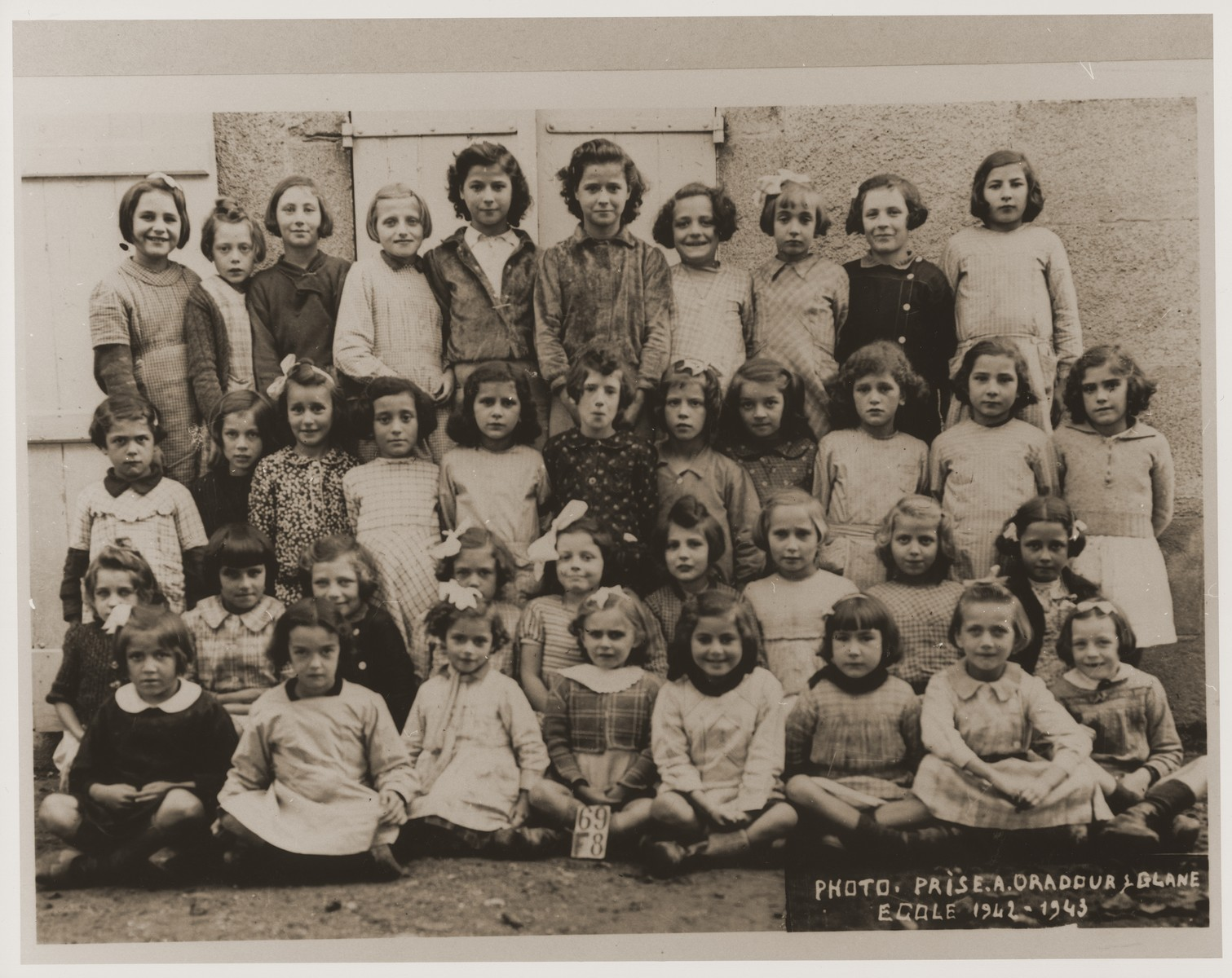 A group portrait of a class of girls at a school in Oradour.  All of the children pictured were killed by the SS during the June 10, 1944 massacre.