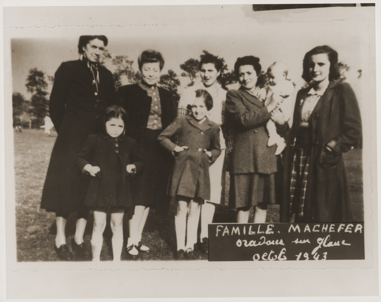 The Machefer family poses together in Oradour.    All of the people pictured here, except for the father, were killed by the SS during the June 10, 1944 massacre.