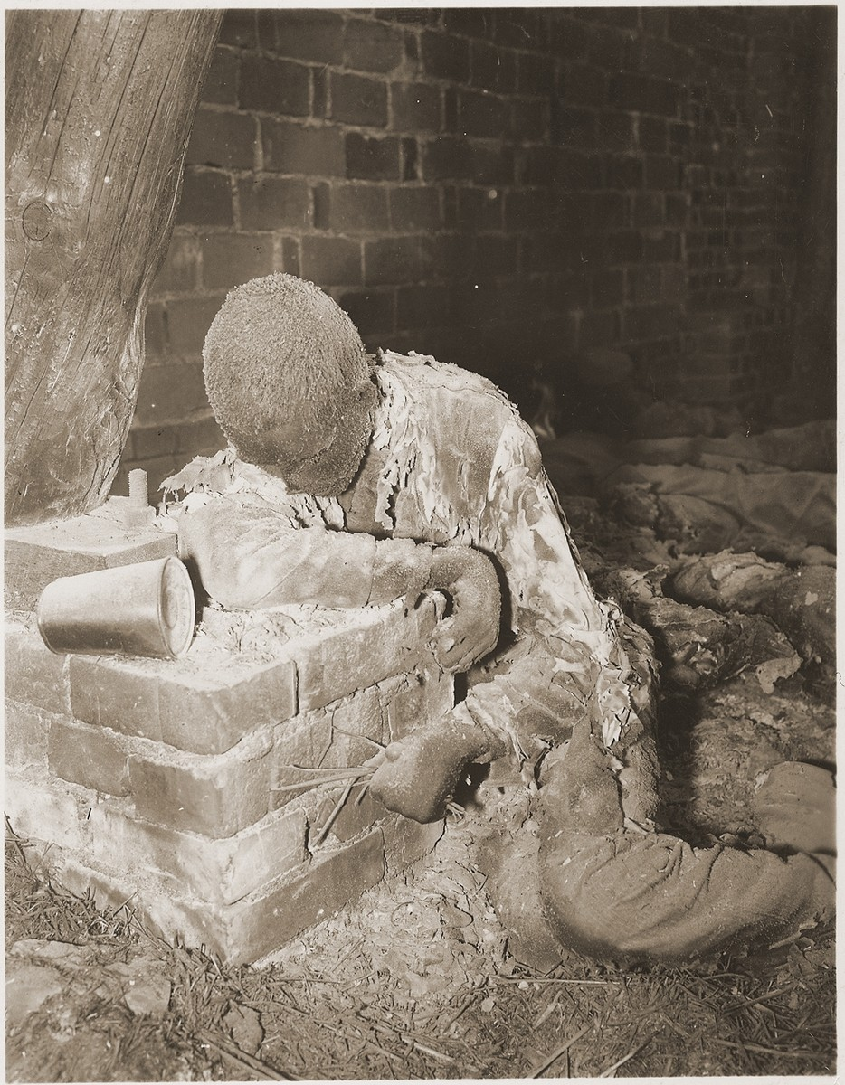 The charred corpse of a prisoner killed by the SS in a barn just outside of Gardelegen.