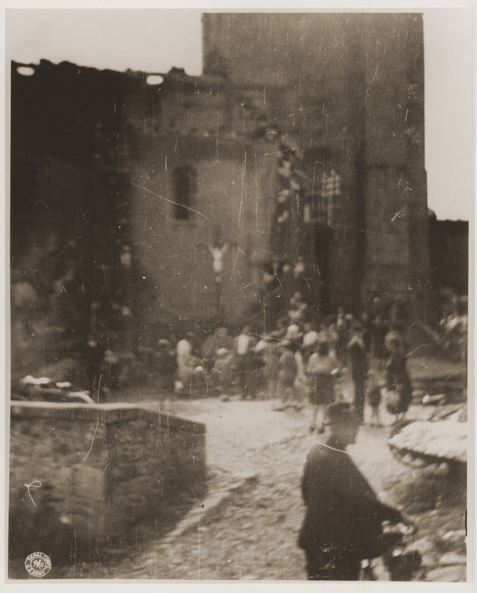 French civilians enter the ruins of a church in Oradour where SS troops killed the village's women and children during the massacre.