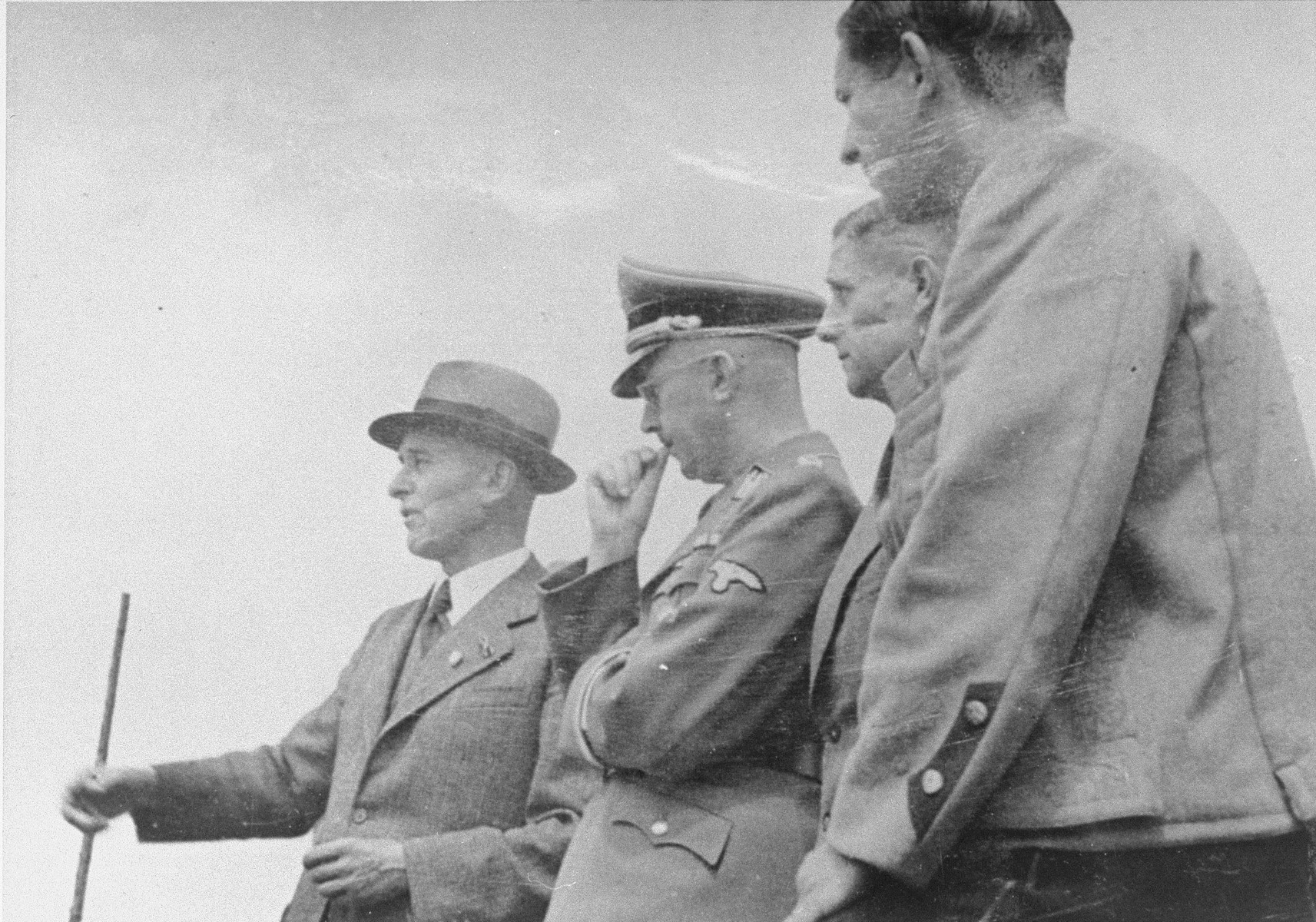 Reichsfuehrer SS Heinrich Himmler stands alongside Max Faust (wearing the fedora) and other IG Farben engineers during a tour of the Monowitz-Buna building site.  Faust, who was an IG Farben engineer, was the head of building operations at Monowitz-Buna.