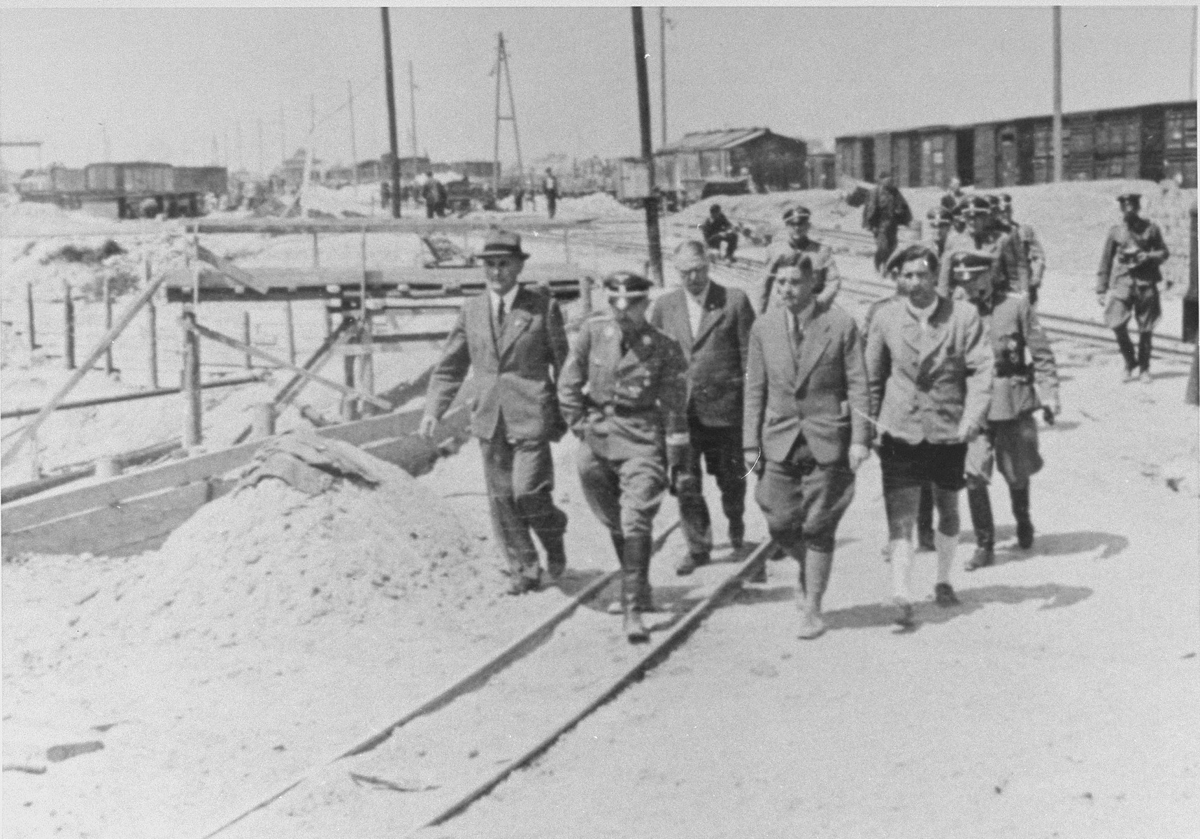 Reichsfuehrer SS Heinrich Himmler tours the Monowitz-Buna building site in the company of Max Faust (first on the left).   Faust, who was an IG Farben engineer, was the head of building operations at Monowitz-Buna.