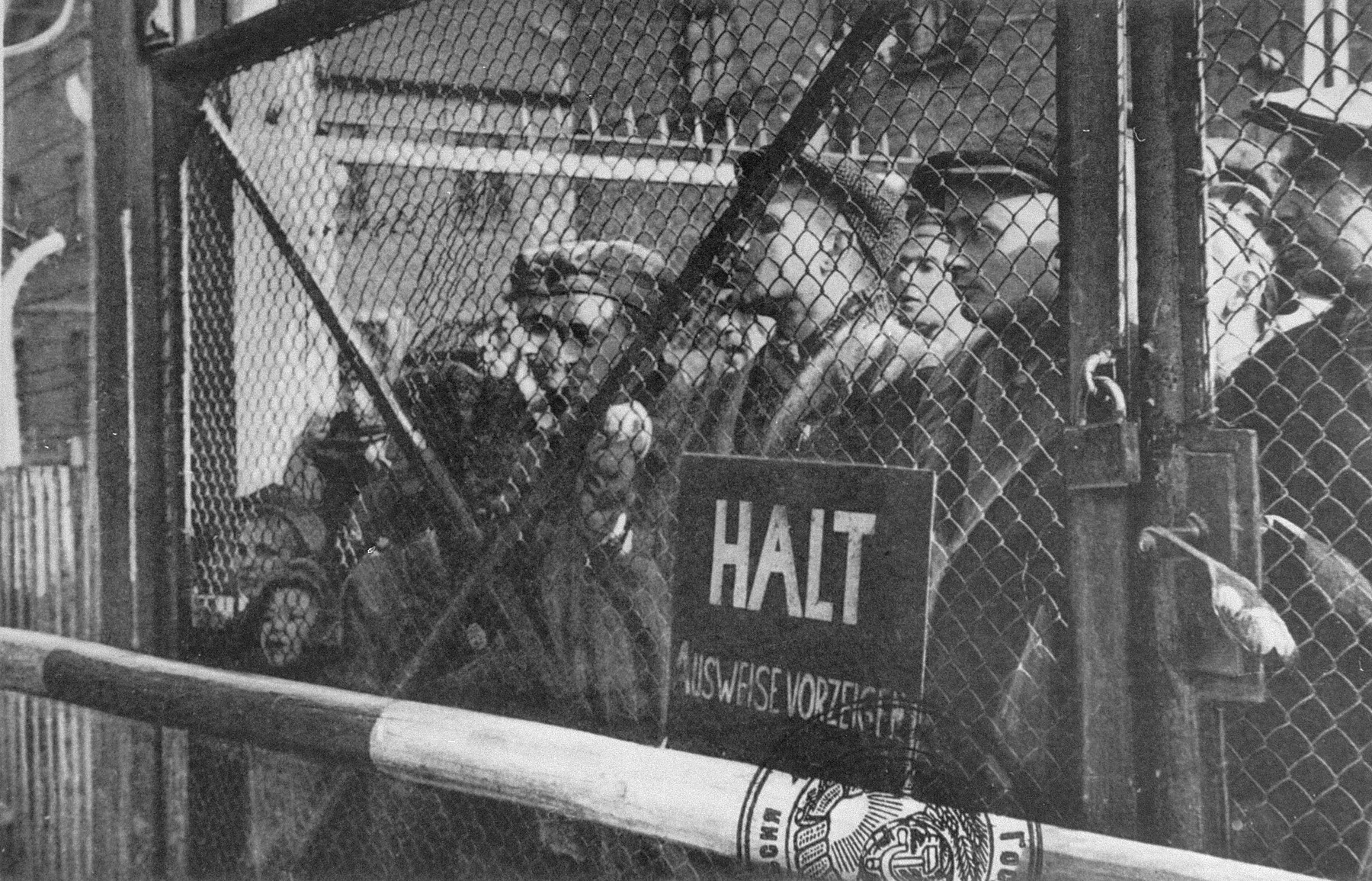Inmates at the gate to the Auschwitz concentration camp.