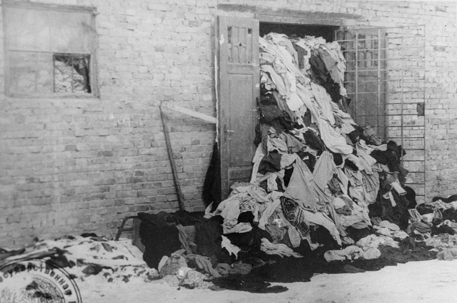 View of one of the warehouses in Auschwitz, which is overflowing with clothes confiscated from prisoners.