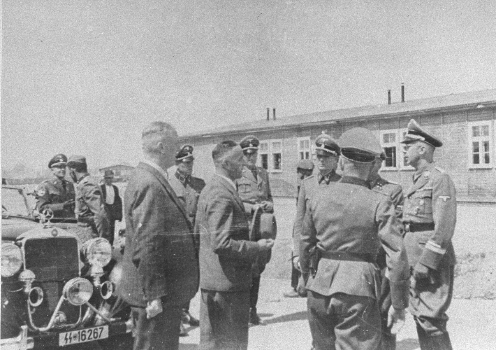 Reichsfuehrer SS Heinrich Himmler converses with Max Faust (holding the fedora) during a tour of the Monowitz-Buna building site.  Faust, who was an IG Farben engineer, was the head of building operations at Monowitz-Buna.