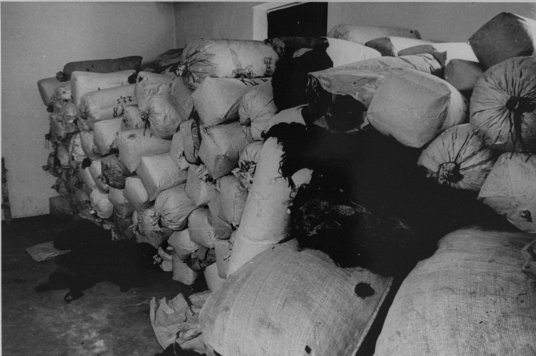 Bales of human hair ready for shipment to Germany found in one the Auschwitz warehouses when the camp was liberated.   In Auschwitz 7,000 kilos of human hair was found at liberation.
