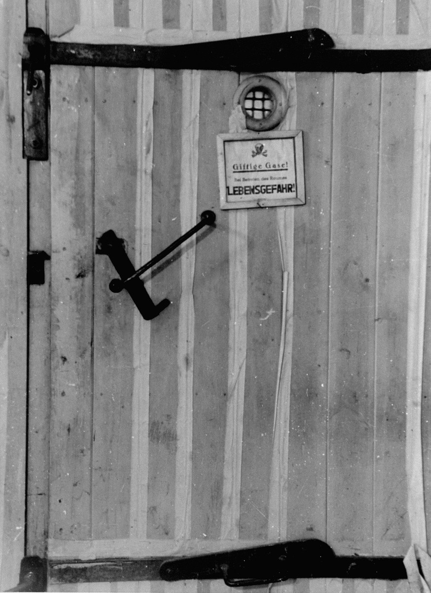 A door to a de-lousing chamber in Auschwitz. The note reads: Harmful gas! Entering endangers your life.