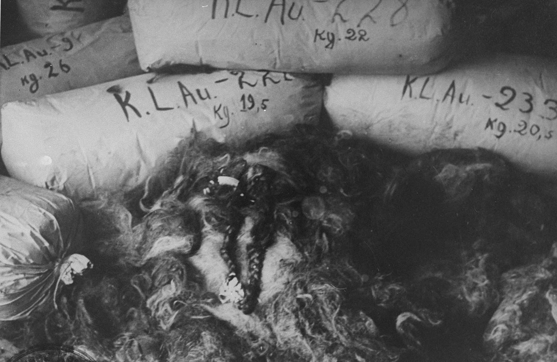 Bales of the hair of female prisoners found in the warehouses of Auschwitz at the liberation.