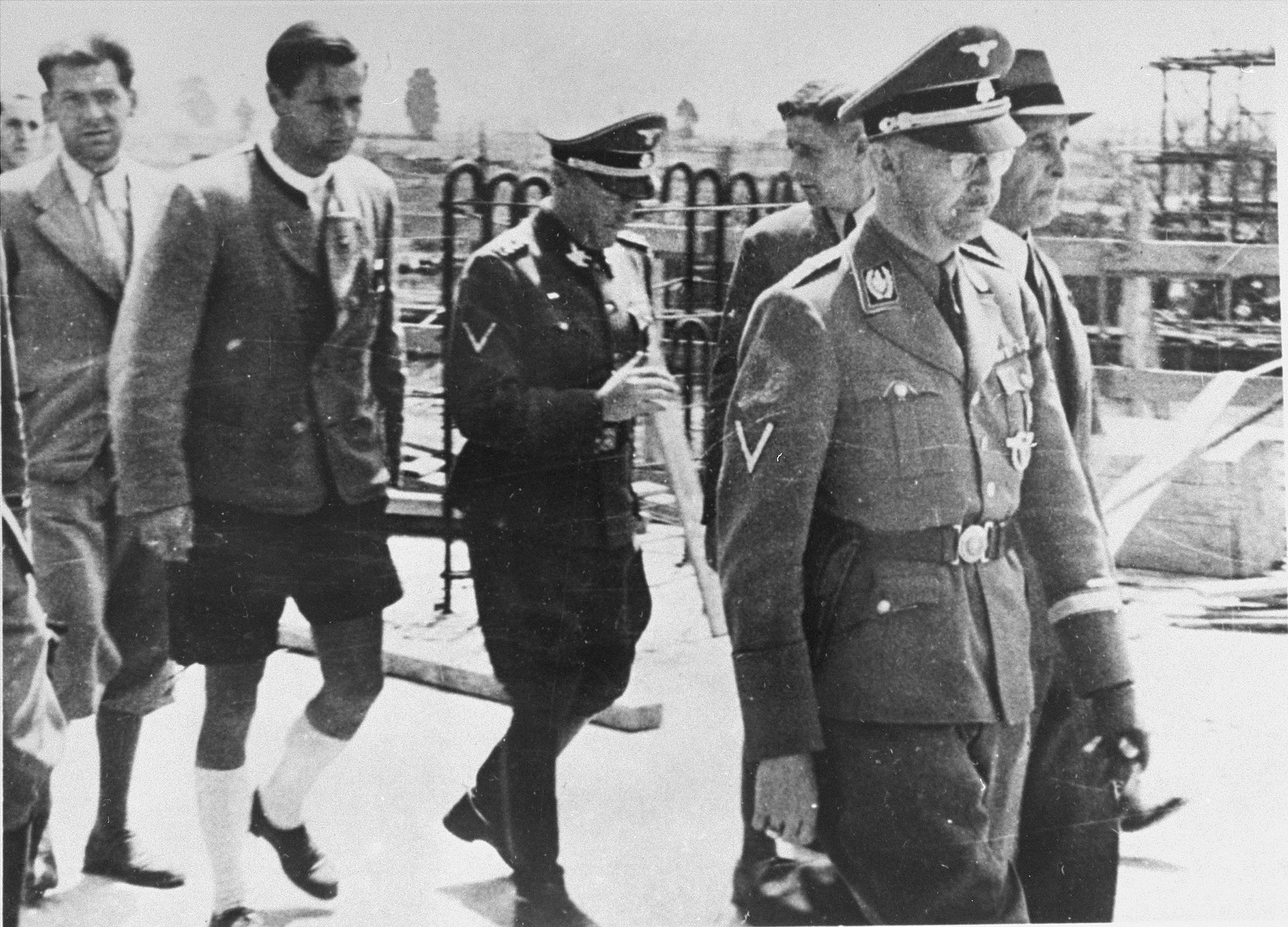 Reichsfuehrer SS Heinrich Himmler tours the Monowitz-Buna building site in the company of Max Faust (far right, next to Himmler).   Faust, who was an IG Farben engineer, was the head of building operations at Monowitz-Buna.  Pictured in the center is SS-Obergruppenfuehrer and General der Polizei in Breslau, Ernst Heinrich Schmauser
