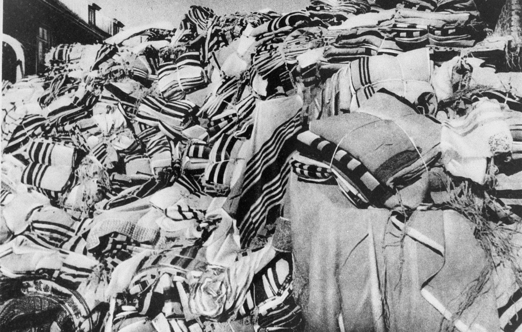 A large pile of prayer shawls (tallesim, tallitot) that were confiscated from arriving prisoners are stored in one of the warehouses in Auschwitz.