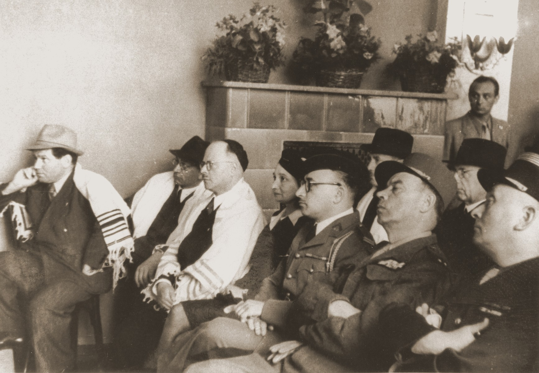 Jewish, German and French officials attend the dedication of the first Berlin synagogue to be re-opened after the war.  The synagogue was located on the fourth floor of the former Jewish home for the aged on the Iranischestrasse in the French sector.  Pictured from left to right are Julius Meyer, unknown, Erich Nelhaus, Lt. Weill, General Lancon and an aide.