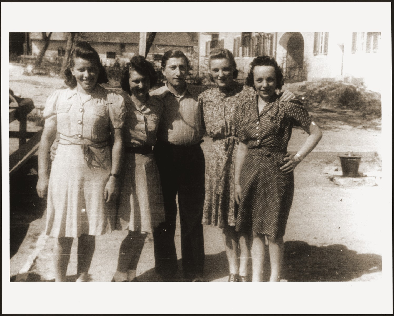 Group portrait of Jewish DPs in the  New Palestine displaced persons camp near Salzburg.   Pictured from left to right are: Regina (from Chrzanow), Mania Reichman (from Bielsko Biala), Moniek Rozen (from Dabrowa Gornicza), Lola Lerer (from Lodz) and Herta Munk-Zauberman.