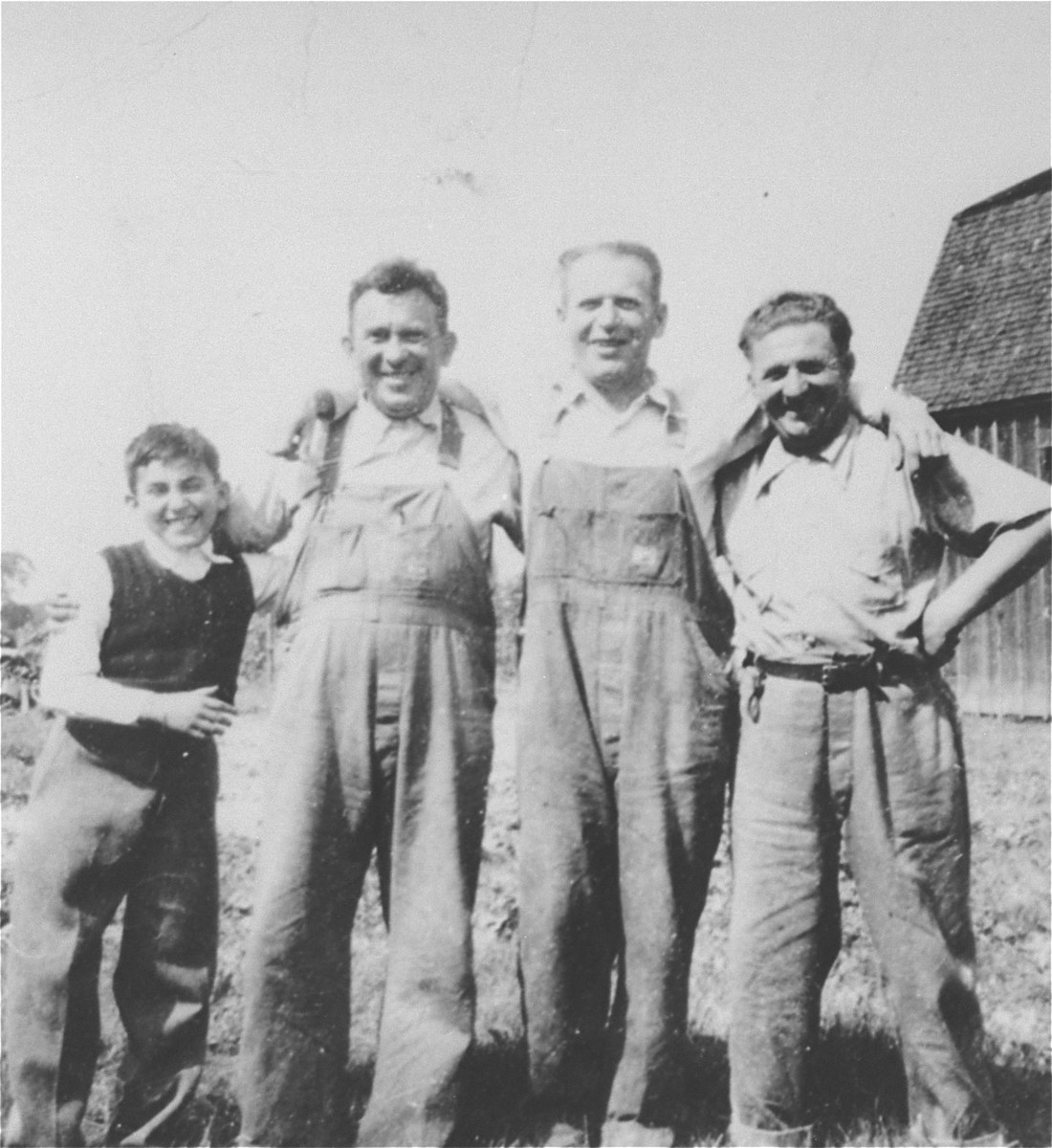 The Muller brothers, Nandor (right) and Lajos (second from the left), pose with a third Jewish refugee from central Europe who was also compelled to become a farmer in order to gain entry into Canada in the late 1930's.
