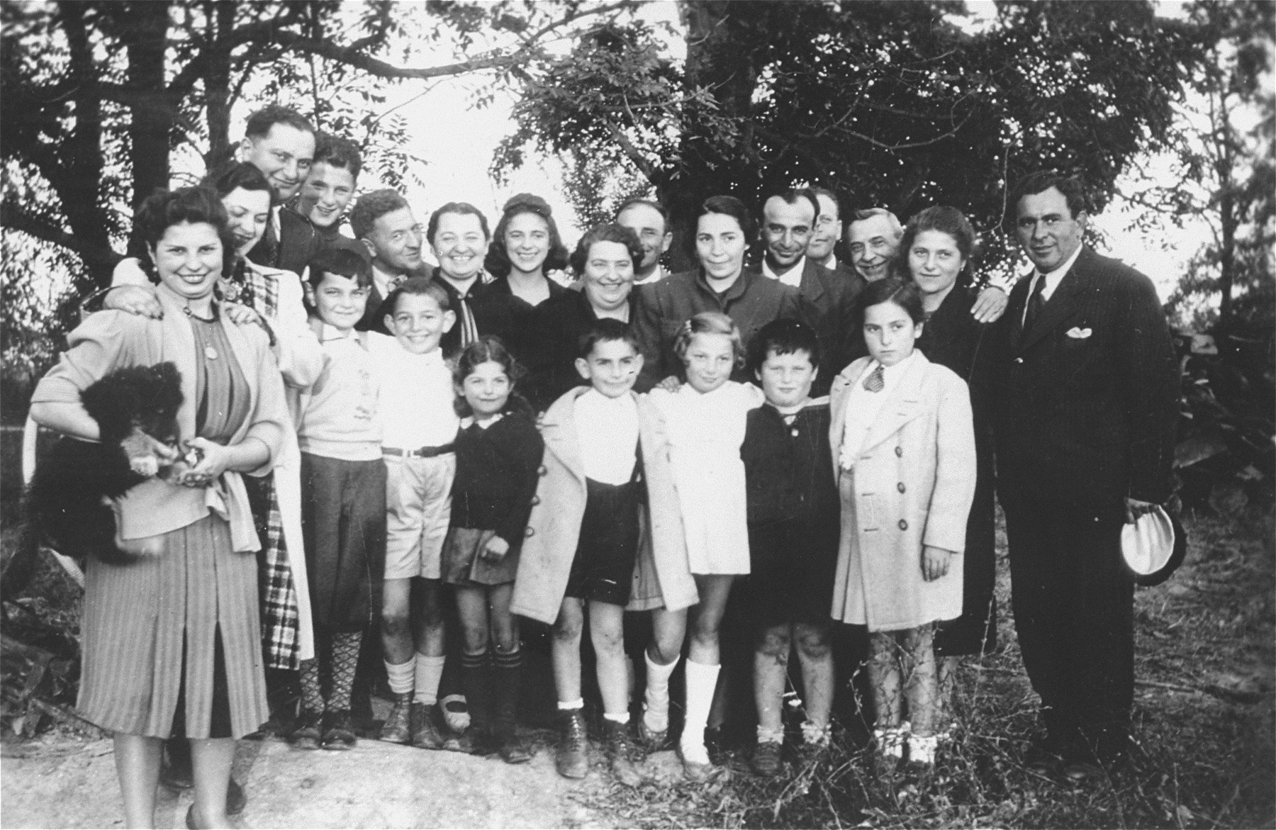 Group portrait taken on the eve of Rosh Hashana, of a number of Slovak and Hungarian-Jewish refugee families who had recently settled on farms in southern Ontario.  Among the families pictured are Leslie and Stephie Weisz, Lajos and Magda Muller, and Nandor and Magda Muller.