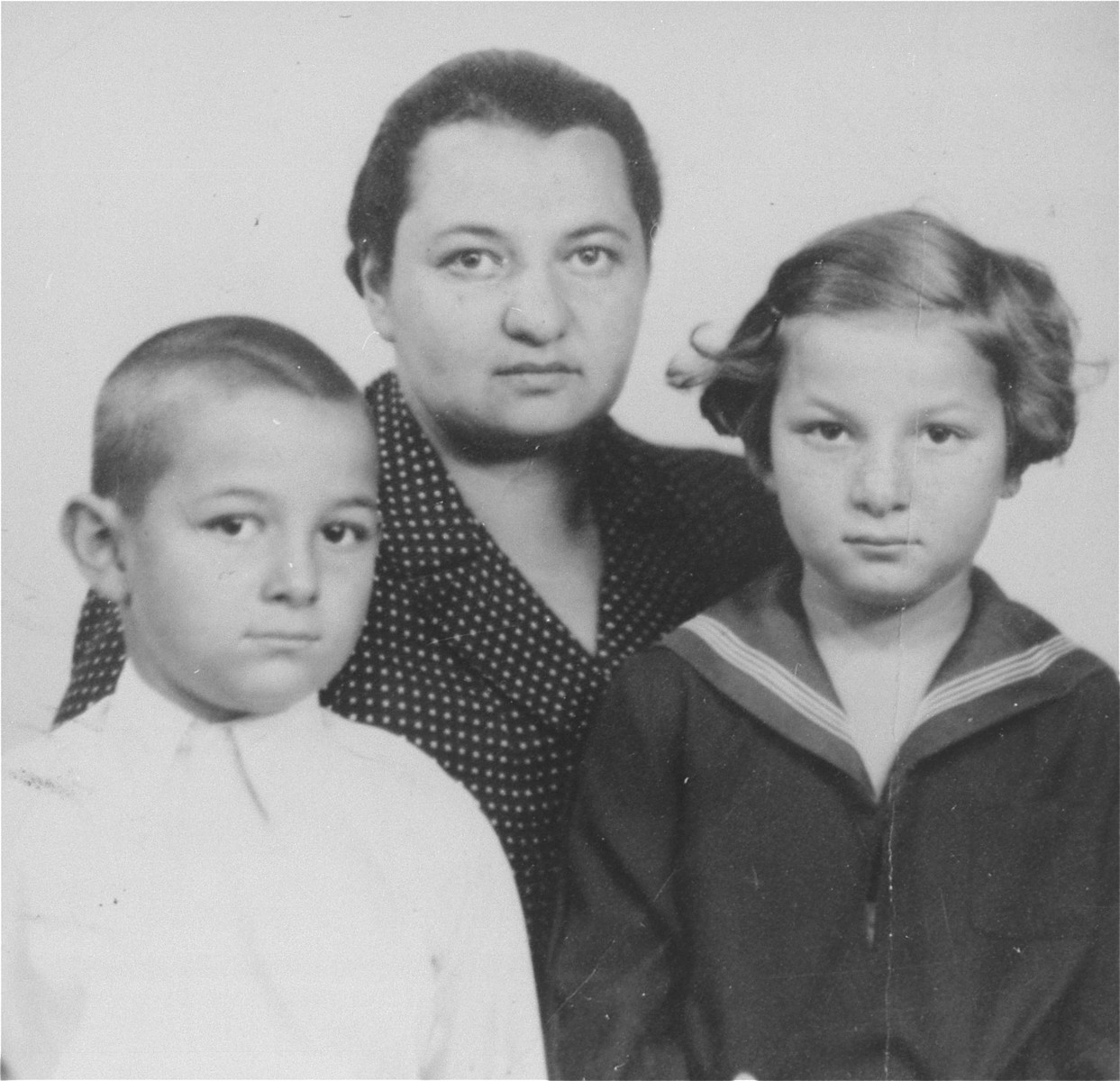 Passport photo of the donor, Magda Herzog Muller and her two children, Heinrich and Alice.    The photograph was taken in London while they awaited a ship to take them to Canada.