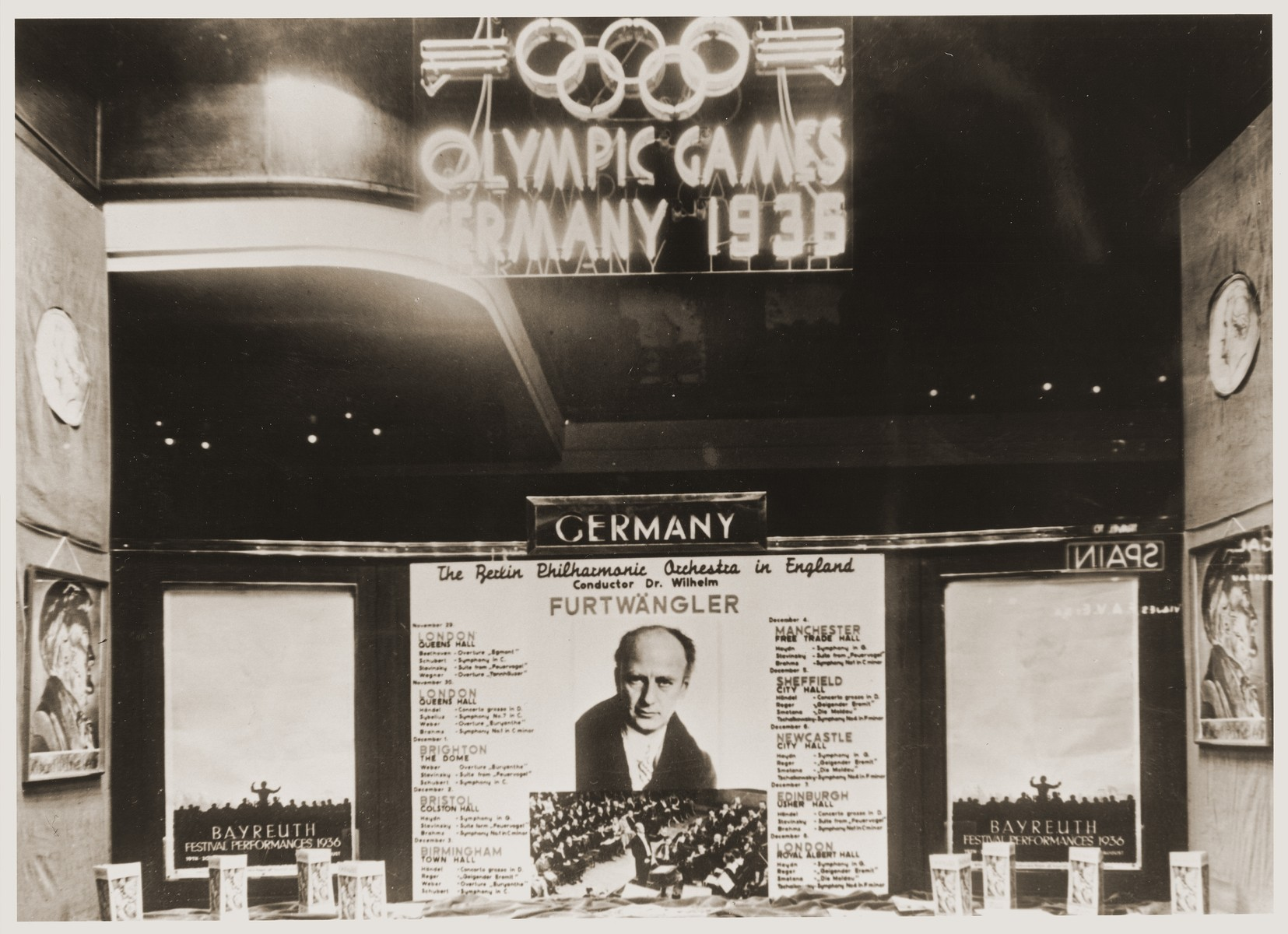 Sign for the 1936 Olympics in a window in England.