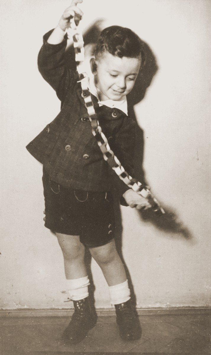 Portrait of a Jewish boy playing with a toy at his preschool.  Pictured is Otto Farago (Friedman), the cousin of the donor.