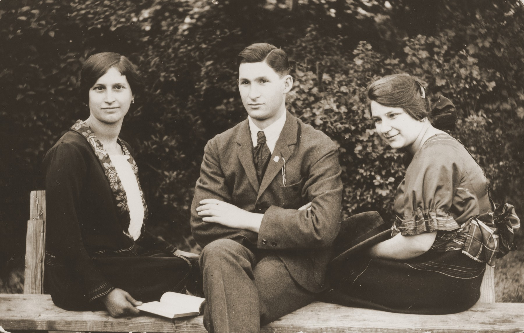 Group portrait of three Jewish siblings in Budapest.  Pictured from left to right are Piri, Andres and Boriska Kupfermann.  They are siblings of the donor's father, Beno Kupfermann.