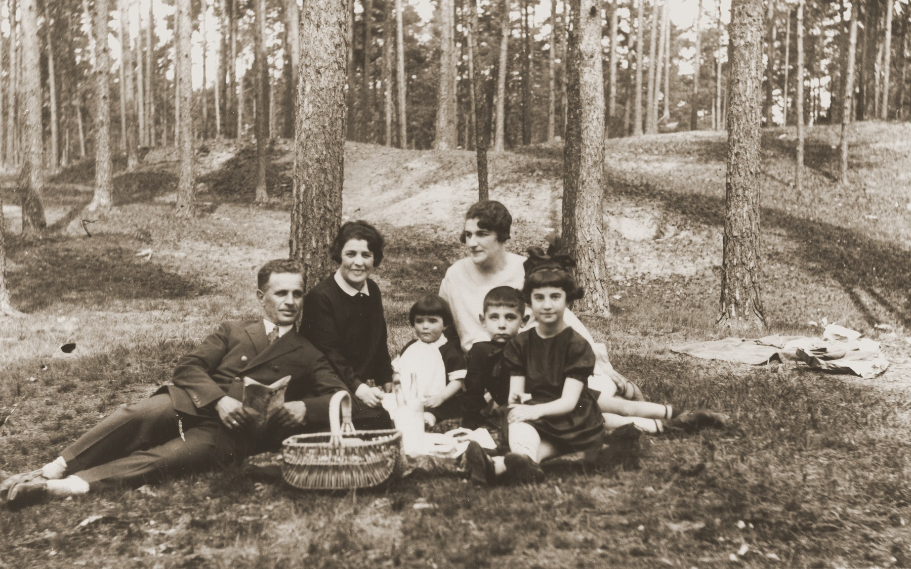 A Jewish family on a picnic in the woods near Riga.   Pictured are Cila Chankin, her husband, Jozef, and their three children.  All were killed during the war.  Cilia was the sister of Jacob Chankin, the donor's uncle.