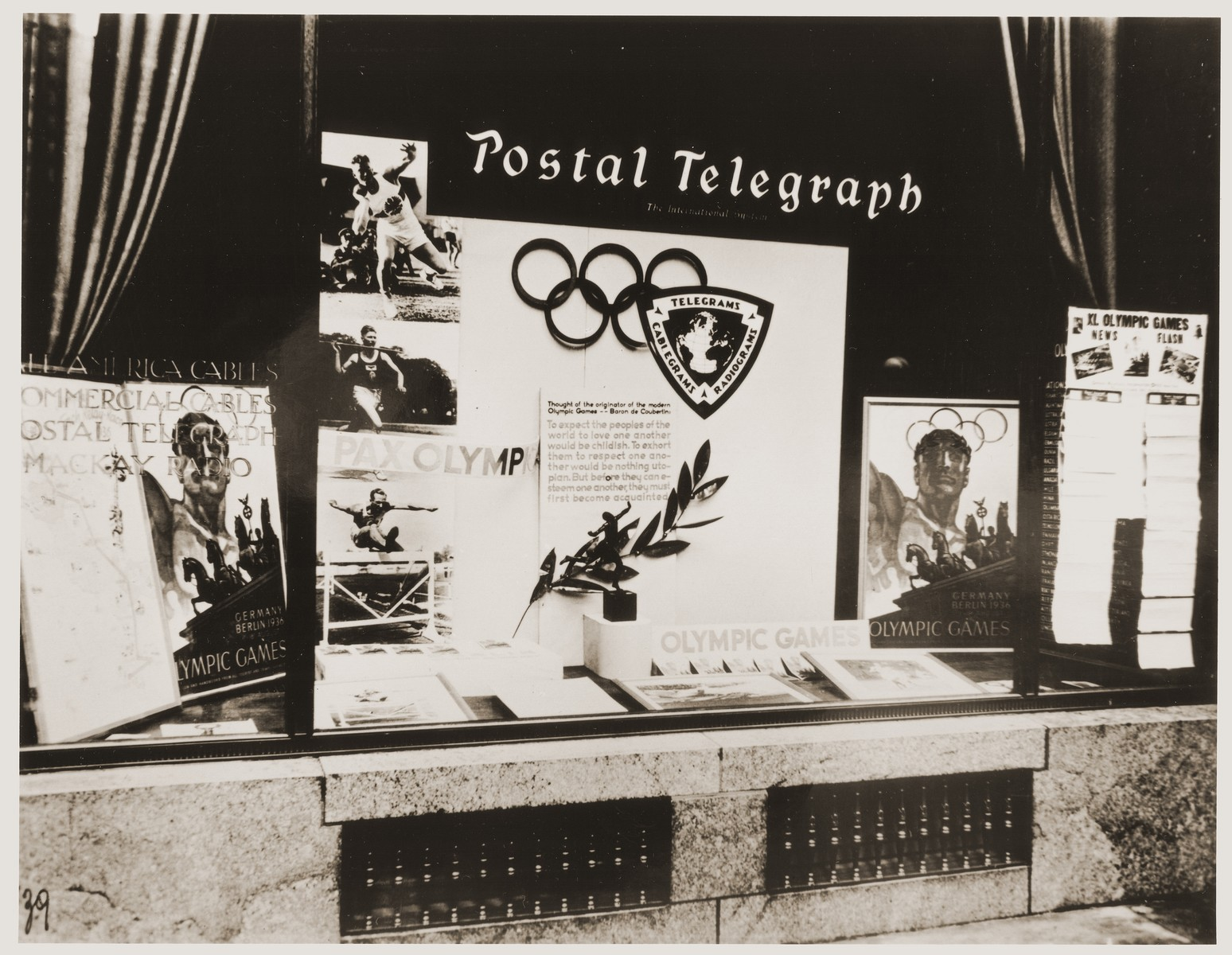 An American travel agency advertises the Summer Olympics in Berlin as well as telegrams, cablegrams, and News Flash Reports on events from the Olympic Games.