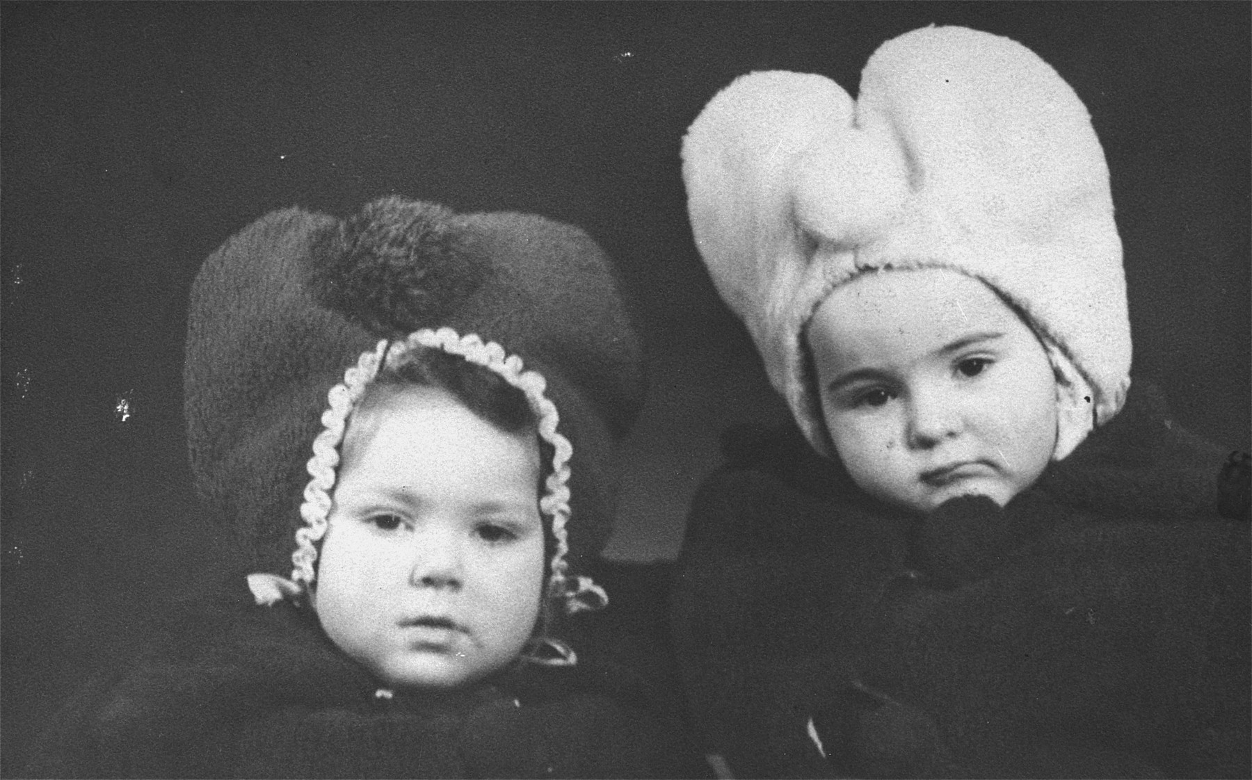 "Portrait of a Jewish child in hiding with her Lithuanian ""sister"".  Pictured are Henia Wisgardisky (left) and Nijole Stankevic (right), the daughter of her rescuers, Jonas and Joana Stankiewicz."