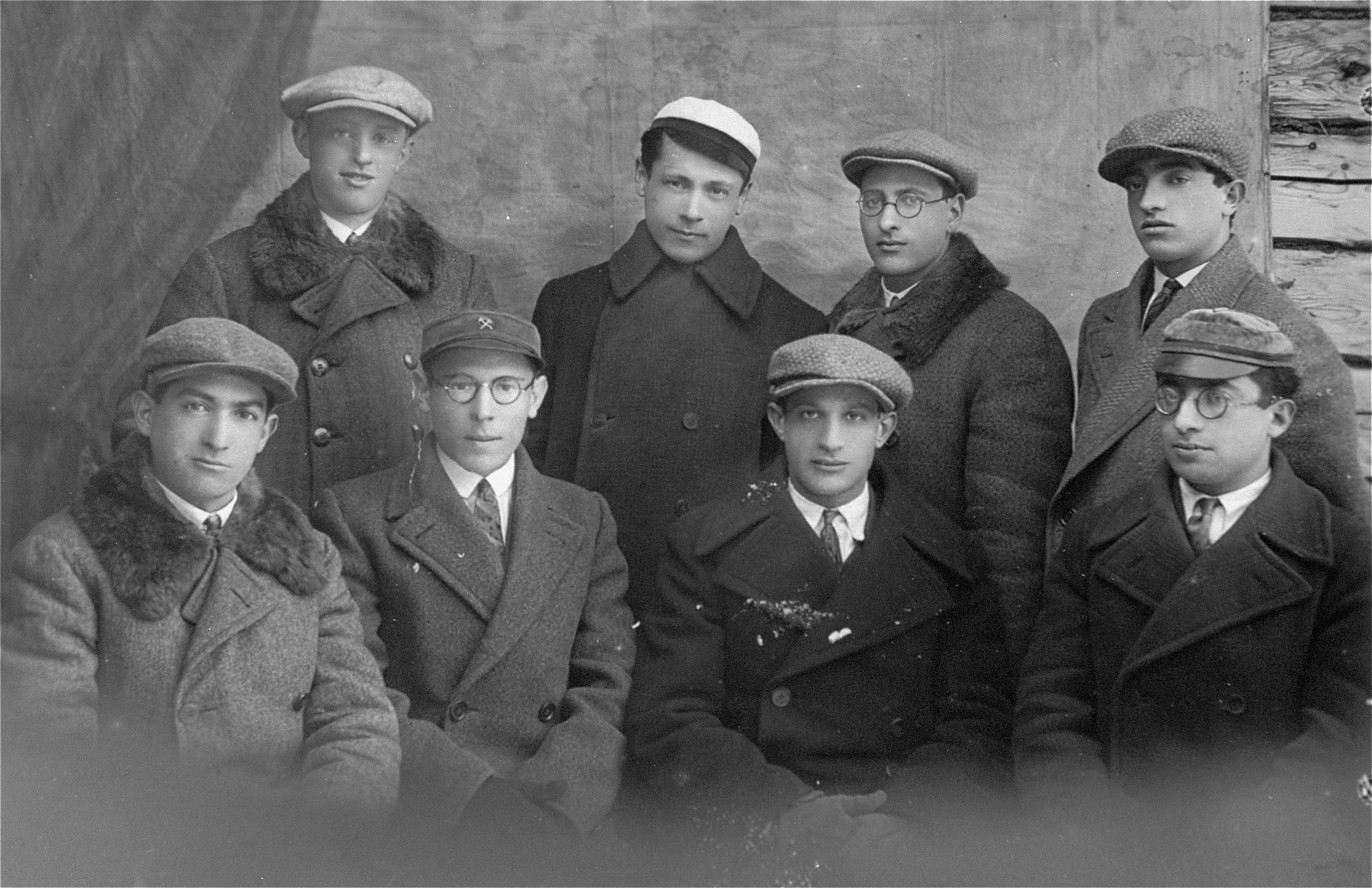 Group portrait of young Jewish men in Lithuania. Pictured at the top right is the donor's father, Eliezer Kaplan.