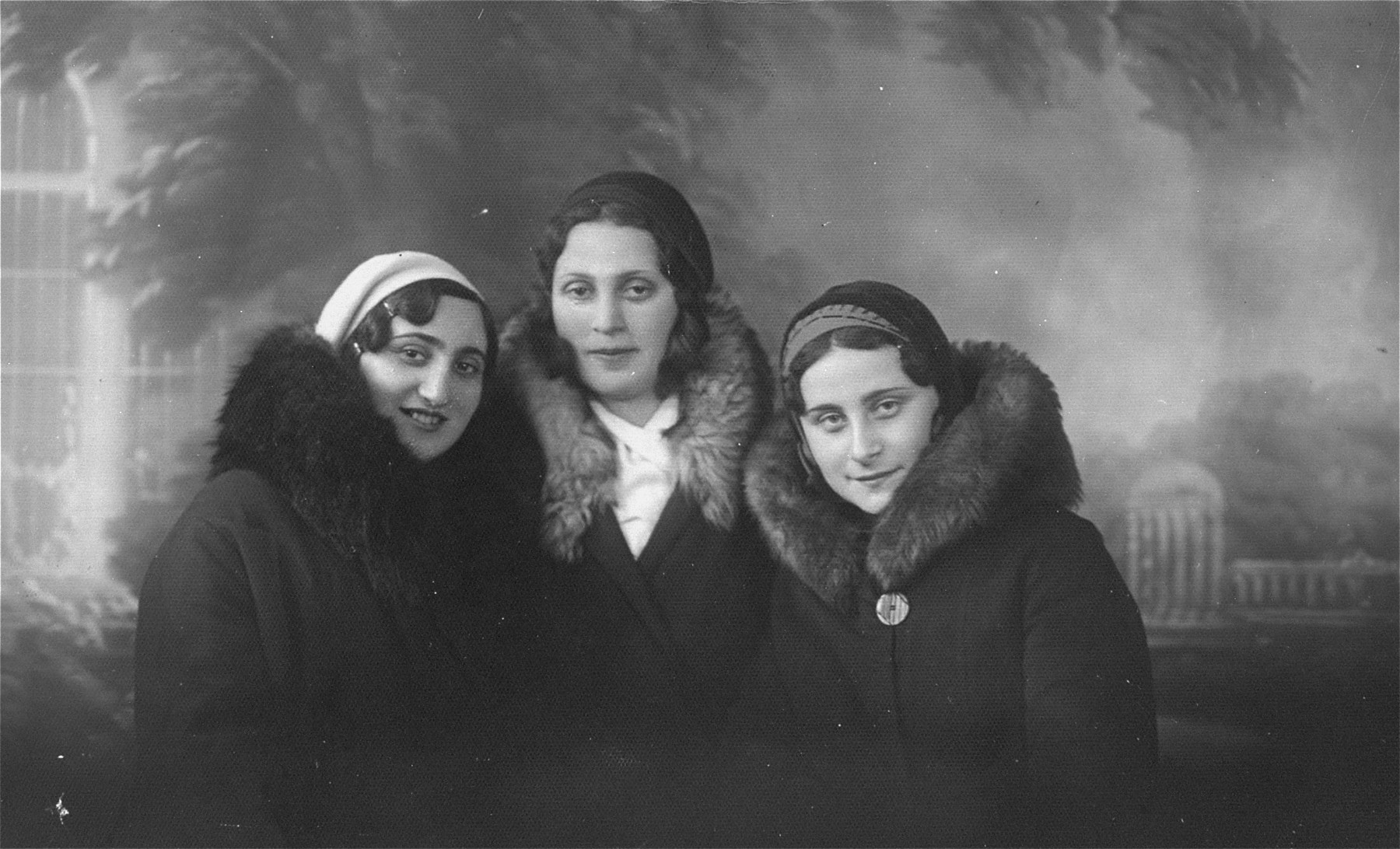 Studio portrait of three young Jewish women in Lithuania.  Pictured at the left is Esther Kaplan, the cousin of Eliezer Kaplan.