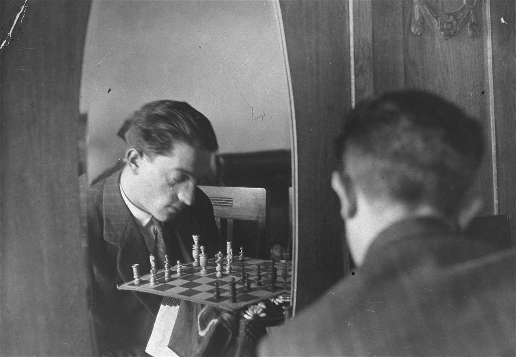 Portrait of the donor's father, Eliezer Kaplan, playing chess.  The photograph was taken through a mirror.