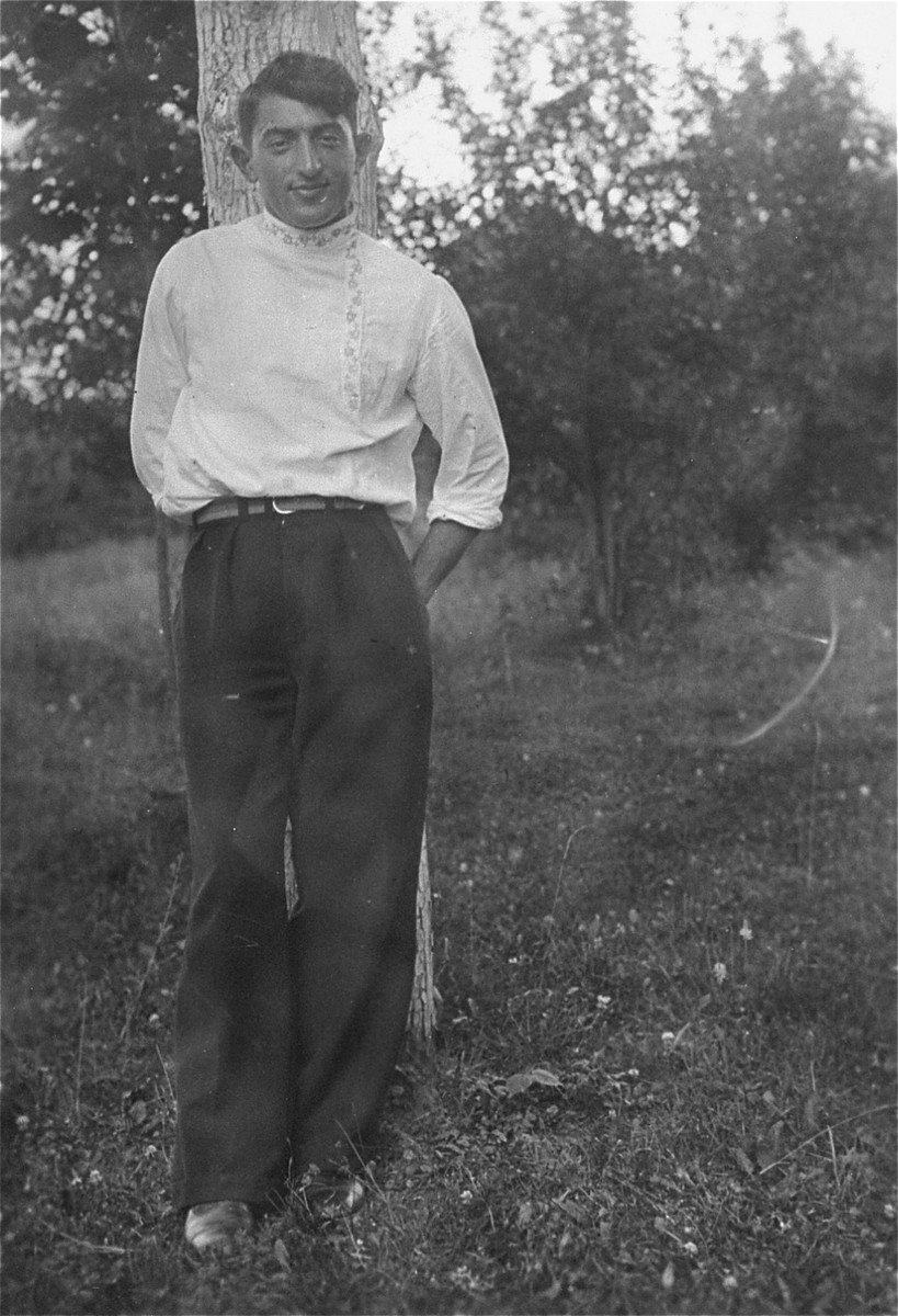 """Portrait of the donor's uncle, Moshe Kaplan, wearing an embroidered blouse (a Jewish folkdancing costume).   The photograph is inscribed in Hebrew: """"Examine this picture and recognize that this is your brother. A souvenir for you, my brother, Eliezer, from your brother, Moshe."""""""