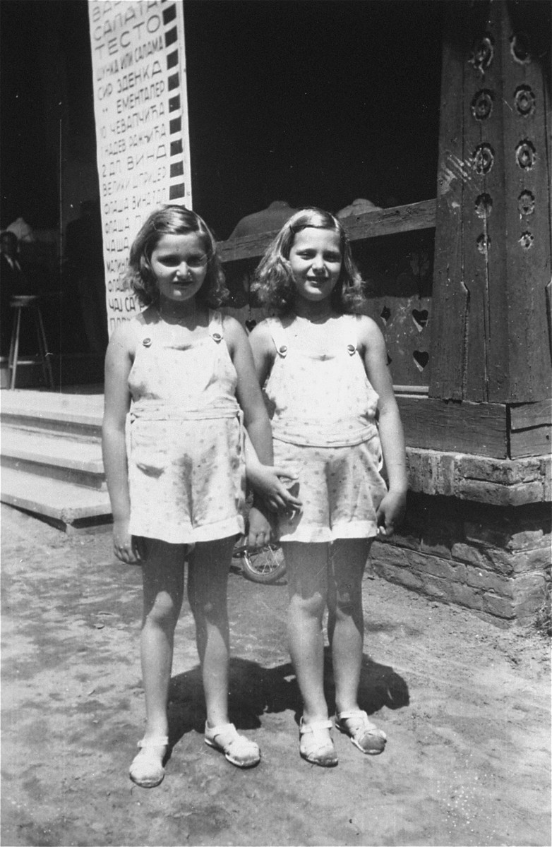 Dorottya (Dolly) and Ida Marianne (Mari) Dezsoefi  pose in the street during a resort vacation.