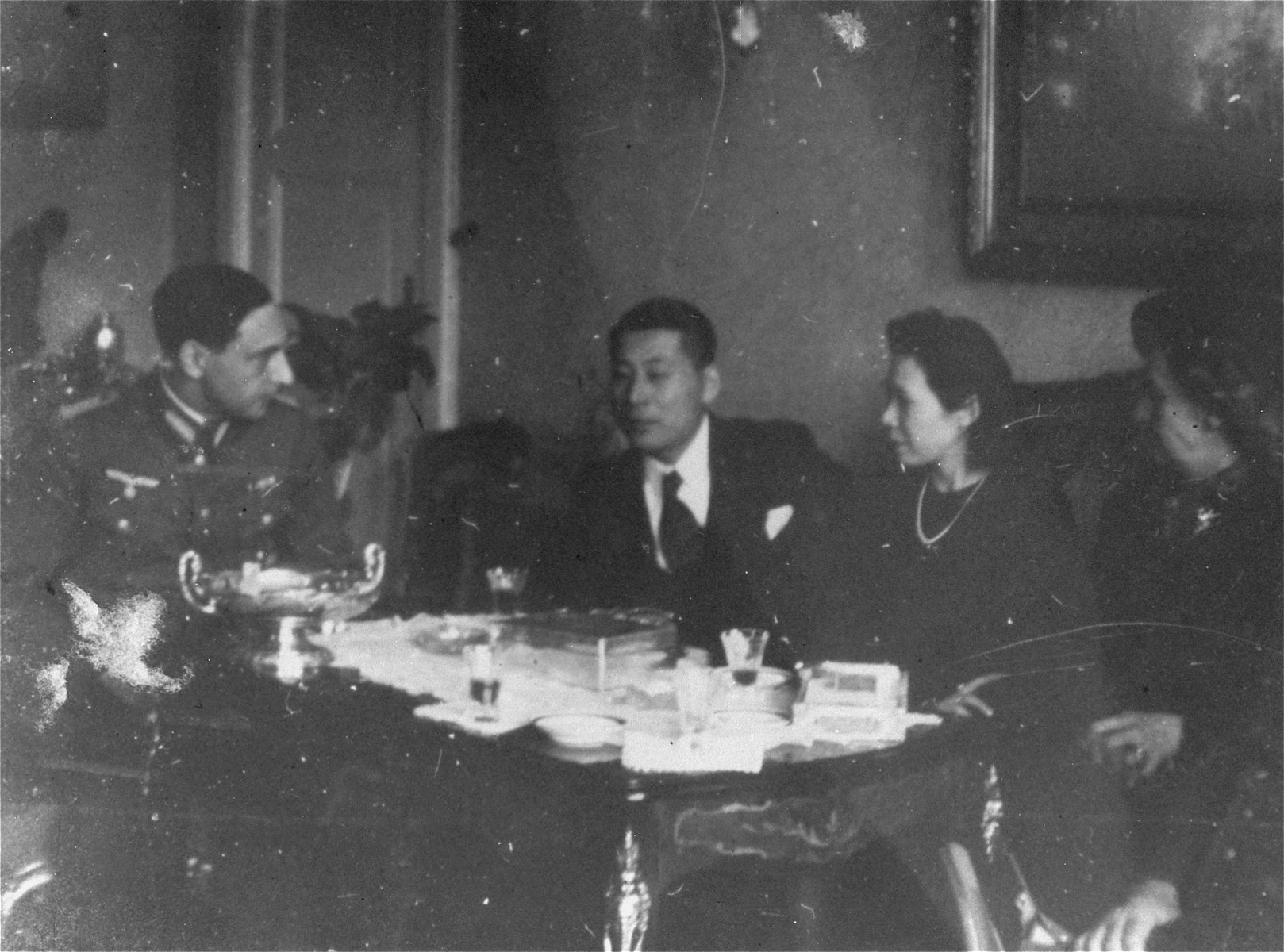Chiune and Yukiko Sugihara dine with a German officer in Berlin.