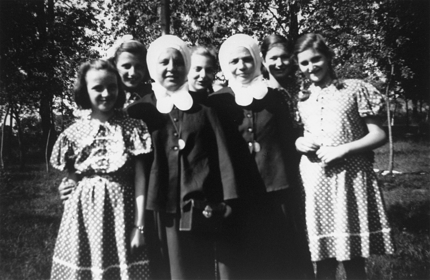 Dorottya Dezsoefi (first row, right) and her twin sister Ida Marianne (second row, center) pose with two nuns outside of the convent school where they were hidden for two years.    Sister Gabriella is in the first row, beside Dorottya.