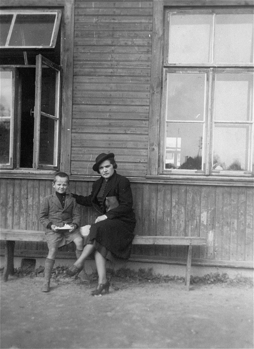 Chaya Gar sits with a young cousin in front of a school in Pren, Lithuania.
