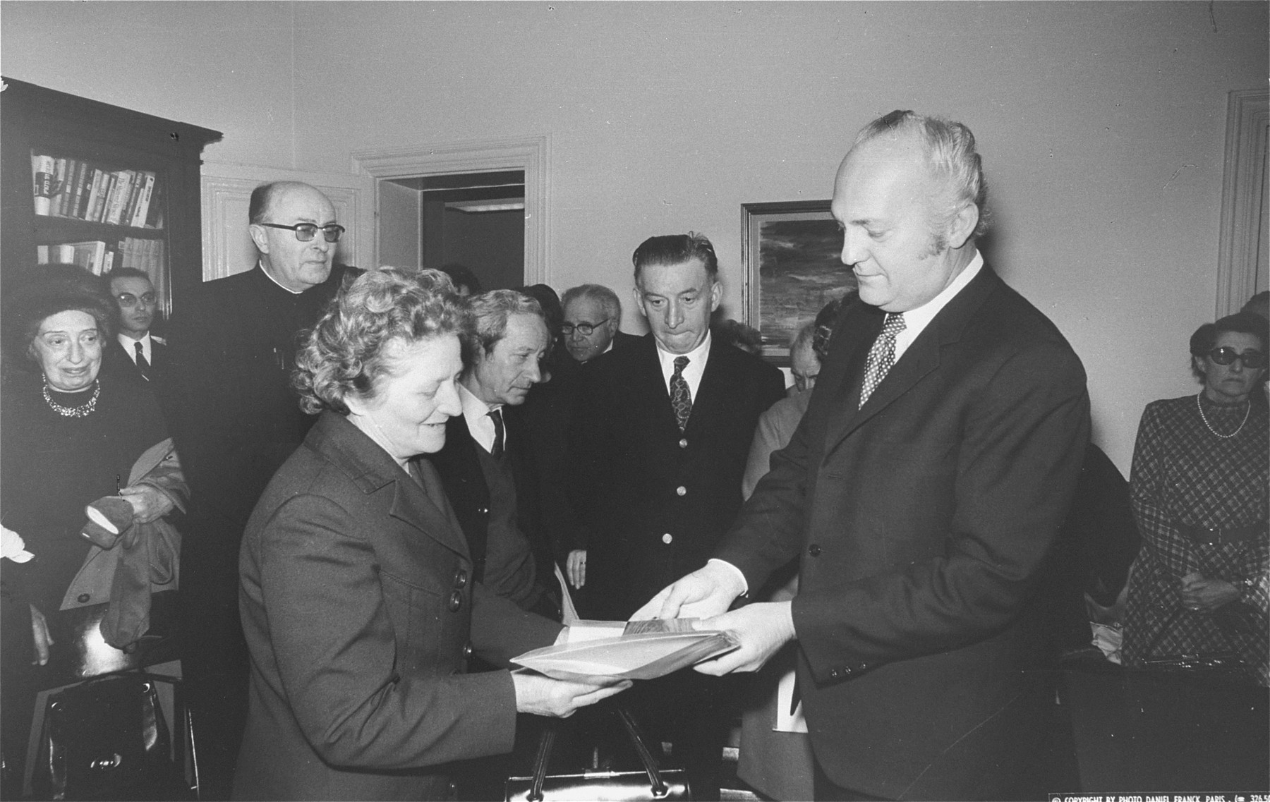 The Israeli ambassador in Paris presents Agnes Bertrand with a plaque naming her as one of the Righteous Among the Nations.
