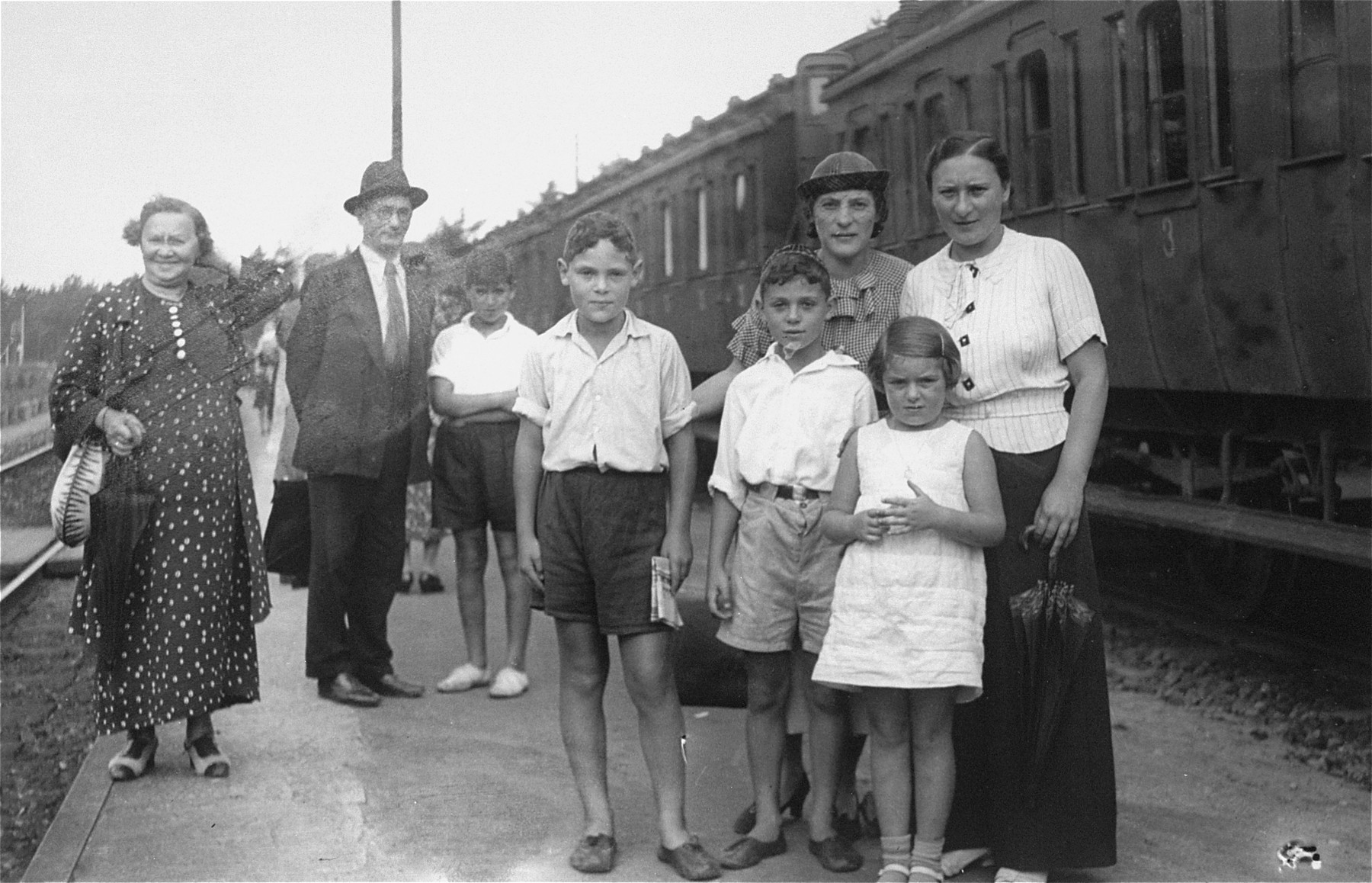 A Jewish family poses at a train station in Riga.  Among those pictured are Debora Nurock and Chassia Rosenthal.