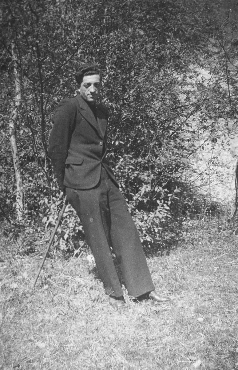 Portrait of the donor's father, Eliezer Kaplan, balancing himself on a cane.
